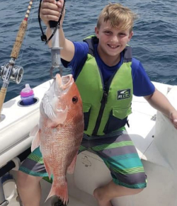 Kid holding fish